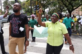 Director of Sport, Christopher Jones and Minister within the Ministry of Natural Resources, Simona Broomes among youth at the picketing exercise.