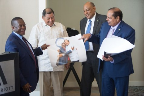 Prime Minister, Moses Nagamootoo, Minister of Natural Resources, Raphael Trotman, Minister of Indigenous Peoples Affairs, Sydney Allicock and Deputy Minister of Mineral Resources, Godfrey Oliphant smiles as PM Nagamootoo shares an enlarged photo of himself and the Deputy Minister from his Monday courtesy visit.
