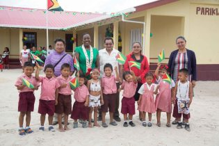 Minister of Education, Dr. Nicolette Henry and Region 9 Regional Chairman, Brian Allicock along with teachers at the newly commissioned Annexe of Arapaima Nursery School in Tabatinga, Lethem