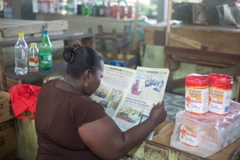 Vendor reading Education Sector Newspaper.