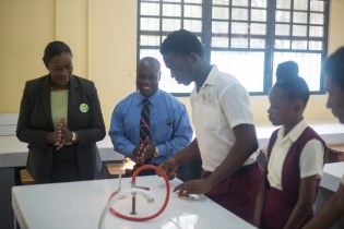 Minister of Education, Dr. Nicolette Henry viewing a student's demonstration in the newly commissioned science lab at the Vryman's Erven Secondary School.