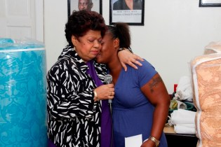 Minister of Social Protection, Amna Ally consoles grieving fire victim, Tonya George.