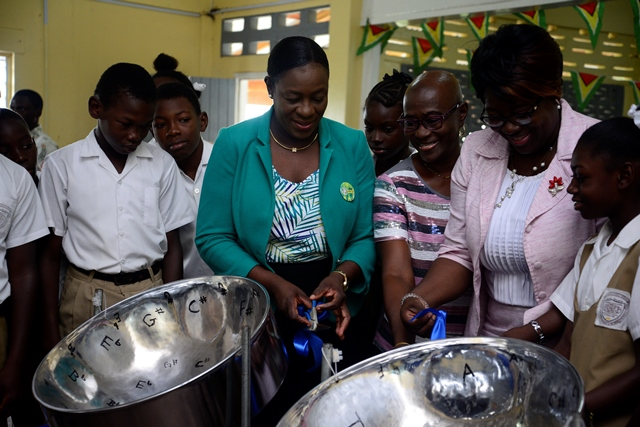 Minister of Education, Nicolette Henry commissioning the steel pans.