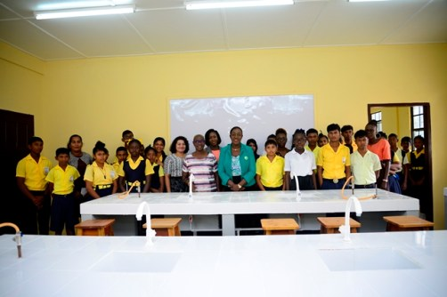 In the photo, students of the Woodley Park Secondary School along with Minister of Education, Dr. Nicolette Henry [center].