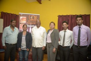 Minister of Finance, Winston Jordan with company owner Peter Abai [left] and other employees of Demerara Bakery
