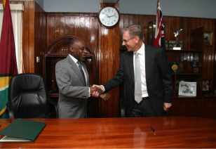 The Foreign Minister and High Commissioner celebrate the signing of the Air Services Agreement.