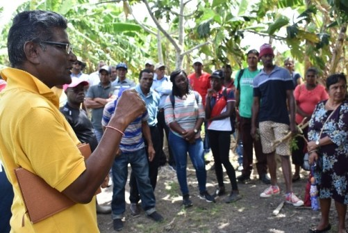 Regional Market Coordinator, Mr Milton Dookie, talking to farmers who participated in the farmers' exchange visit, recently held in Crabwood Creek, Berbice, Region 6.