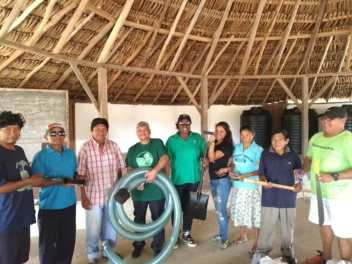 Minister within the Ministry of Finance, Jaipaul Sharma accompanied by the Region 3 REO, Jennifer Ferreira-Dougall handed over farm tools and sport equipment to Maruranau's Toshao Ambrose Bento and the Village Council