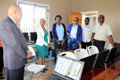 Minister Norton and his team receiving a tour of youth-friendly centre owned by Humanitarian Mission Inc.