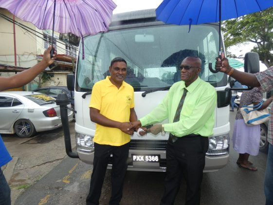 Regional Chairman, Renis Morian hands over keys of the bus to Regional Education Officer (REO), Rabindra Singh