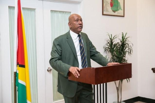 H.E. Ambassador Karran, delivering a speech before the hoisting of the Golden-Arrow Head.