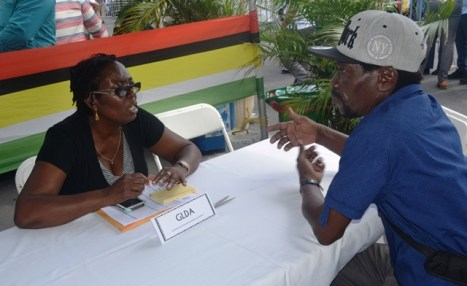 An official from the Guyana Livestock Development Authority enagages an individual that visited the booth.