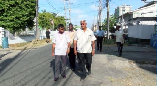 Minister of Agriculture, Noel Holder and Mayor of Georgetown, Ubraj Narine during their walkabout in Newtown Kitty.