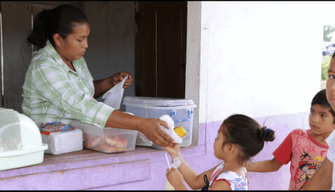 Sonita Earnest serving one of her young customers