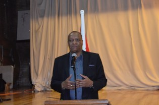 Minister of State, Mr. Joseph Harmon addresses members of the Guyanese diaspora last evening at the St. Stephen's Church Hall, New York