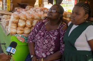 Bread Vendor, Angela Armstrong and her daughter.