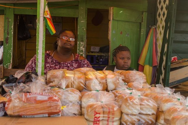 Bread Vendor, Angela Armstrong and one of her daughters.