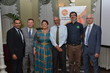 Minister of Business, Dominic Gaskin poses with tourism stakeholders
