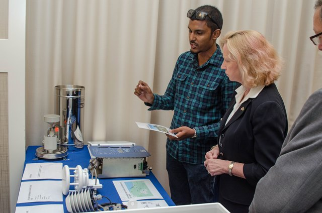 US Ambassador to Guyana, Sara-Ann Lynch is given an explanation of how the device works.