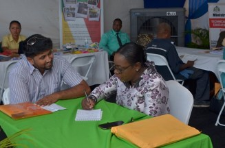 Minister of Education, Dr. Nicolette Henry, addressing the concerns of a citizen.