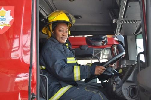 Melesia Martin behind the wheel of a firetruck.