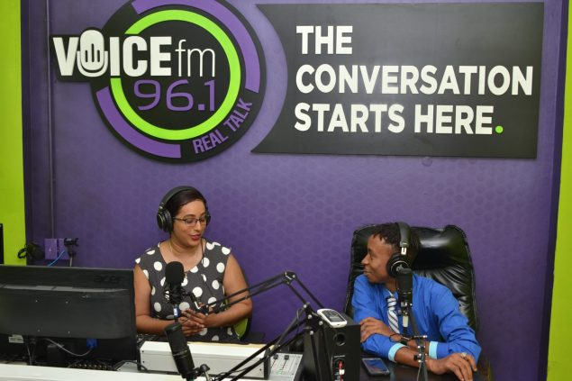 Announcers Leza and Kingsley in studio on air
