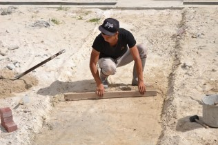A worker casting a passage way in the compound of the facility.