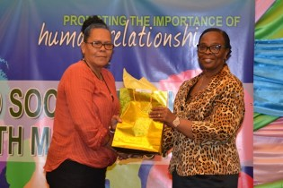 Social Worker receiving token for committed service.