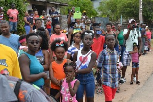 Families along the route to watch the Mashramani Costume and Float Parade.