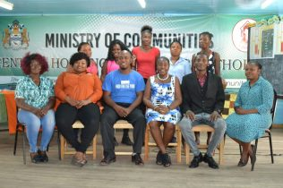 [In the photo, fourth from left] Minister within the Ministry of Communities, with responsibility for Housing, Valarie Adams-Yearwood, staff of the Central Housing and Planning Authority (CH&PA) and the Kingston fire victims and house lots beneficiaries