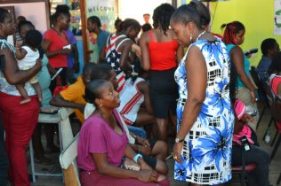 Minister Valarie Adams-Yearwood interacting with some of the residents
