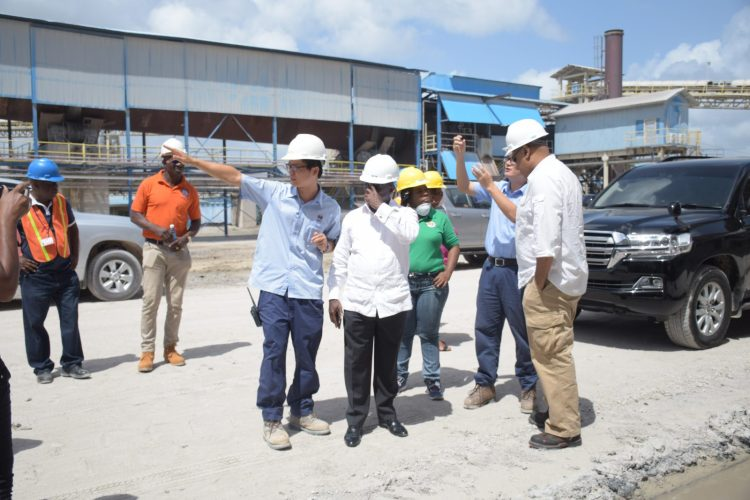 Minister of Natural Resources, Raphael Trotman and South Africa's Deputy Minister of Mineral Resources, Godfrey Oliphant, during a tour of Bosai Minerals Group Guyana Inc., on Friday