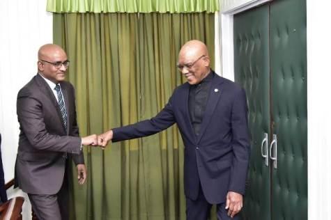 President David Granger greets the Leader of the Opposition, Bharrat Jagdeo.