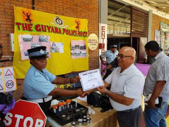 'G' Division of the Guyana Police Force receiving their certificate of participation from Regional Executive Officer, Denis Jaikaran.