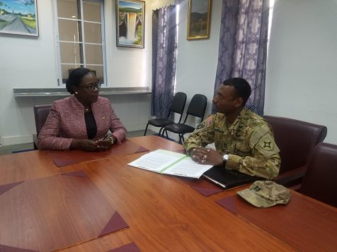 Minister of Education, Dr. the Hon. Nicolette Henry in conversation with Captain Solomon Bannister of the US Army