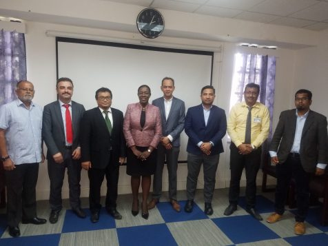 IDB Representatives pose for a photograph with the Minister of Education, Dr. the Hon. Nicolette Henry