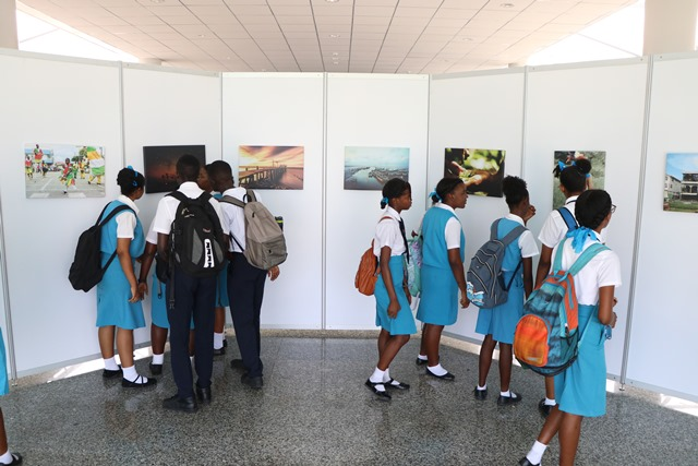 Students viewing the photo exhibition.