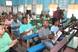 A section of the gathering at the St. Thomas Primary School on D'Urban Street awaiting to be sensitised by Government officials.