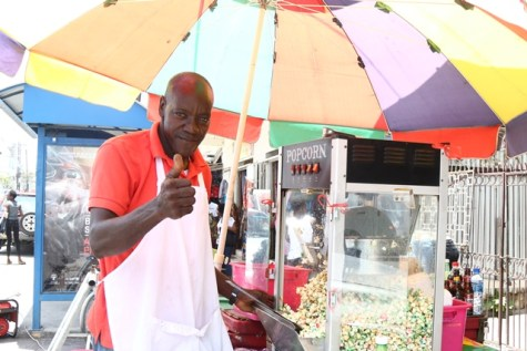 Vendor Leon Gardner gives a thumb's up in support of Friday's court ruling on the December 21 vote in the national assembly.