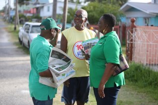 Minister within the Ministry of Social Protection, with responsibility for Labour, Keith Scott speaking with residents along Campbell Avenue during a Government outreach in constituency #3 East and West Campbellville.