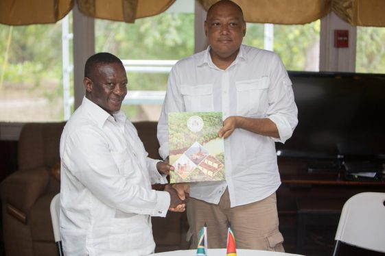 """Minister of Natural Resources, Raphael Trotman and South Africa's Deputy Minister of Mineral Resources, Godfrey Oliphant after the signing of the """"Declaration of Intent"""""""
