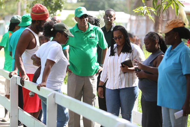 Minister of State, Joseph Harmon engages residents of the community during his walkabout.