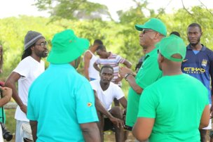 Minister of State, Joseph Harmon engages residents of the community during his walkabou.