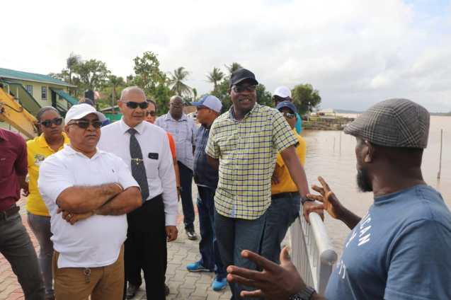 Minister of Public Infrastructure, David Patterson being thanked by a resident of the region for the initiative