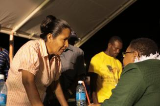 Minister of Public Health, Volda Lawrence listens keenly to the concerns of a resident.