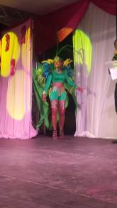 A delegate showcasing her costume wear for the opening segment.