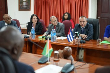 Director of the Division of Consular Affairs and Cuban Residents Abroad, Mr. Ernesto Soberon Guzman (right), makes a point during the meeting between representatives of Guyana and Cuba on providing the framework to review migratory patterns between the two countries.