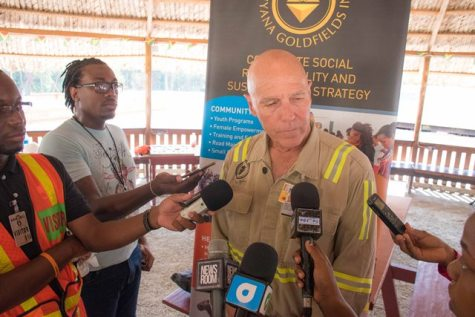 AGM's Chief Executive Officer, Scott Caldwell speak with members of the media following a tour of AGM's Cuyuni/ Mazaruni mining operation.
