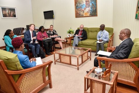 Minister of State, Mr. Joseph Harmon in discussion with the group from the Pan American Health Organisation/ World Health Organisation (PAHO/WHO) in his office today.