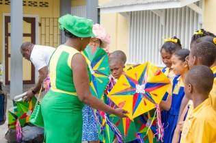 Minister of Education, Dr. Nicolette Henry presents students of the West Ruimveldt Primary School with kites for the Easter holidays.